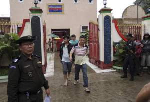 "Chinese nationals, who were jailed for illegal logging, walk out of Myitkyina prison after being released during an amnesty in Myitkyina, the capital of Kachin State, north of Myanmar, July 30, 2015. Myanmar freed some political prisoners and 155 Chinese citizens jailed for illegal logging in an amnesty for nearly 7,000 people on Thursday, a move that could ease diplomatic tensions with influential neighbour China. A total of 6,966 prisoners were pardoned including the Chinese citizens held in Kachin state, of which 153 were given life sentences last week that prompted a diplomatic protest by an ""extremely concerned"" China. REUTERS/Stringer - RTX1MDYY"