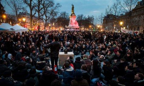 Vive la révolution: demonstrators gather in Place de la République for a nocturnal sit-in. Photograph: Ian Langsdon/EPA