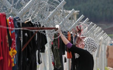 96084918_FILE__This_is_a_Wednesday_March_16_2016_file_photo_of_a_Syrian_refugee_as_she__hangs_clothe-large_trans++jPAKgJRxicfimPcewMJ7fBLcrmo1mhLKr08jNmJN5TQ