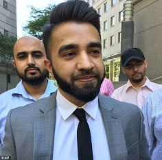 New York Police Department Officer Masood Syed, a practicing Muslim, center, leaves Manhattan federal court in New York Wednesday, June 22, 2016, after a judge ordered the city to reinstate his salary and benefits after he sued the city over police rules requiring that anyone exempt from the department's no beard policy for religious or other reasons limit beard length to one millimeter. The NYPD suspended Syed a day earlier without pay. (AP Photo/Larry Neumeister)